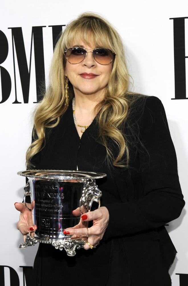 Stevie Nicks of fleetwood Mac poses with the BMI Icon Award at the Beverly Wilshire Hotel on Tuesday in Beverly Hills, Calif.