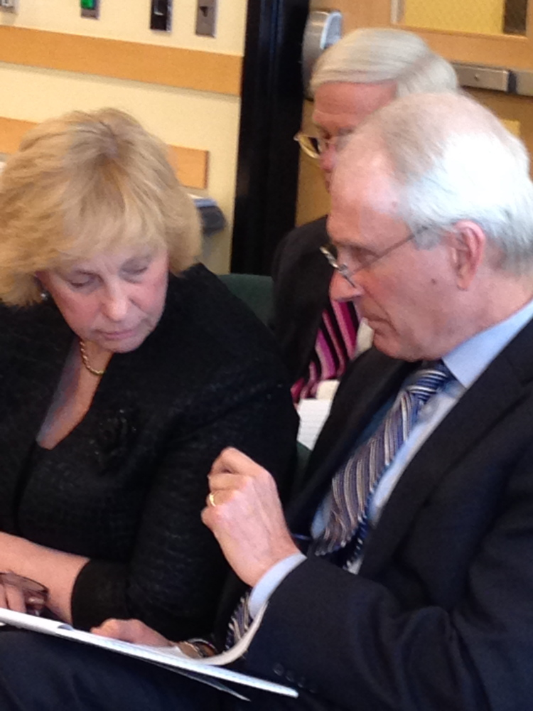 Sheila Pinette, director of the Maine Center for Disease Control and Prevention, consults with an attorney before her Government Oversight Committee testimony earlier this year.