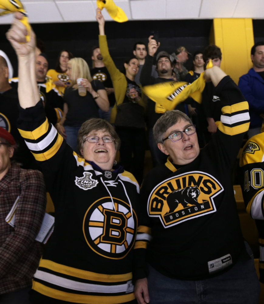 Marcia Hams, left, and Susan Shepherd cheer the Boston Bruins in Boston on Saturday. They were married on May 17, 2004.
