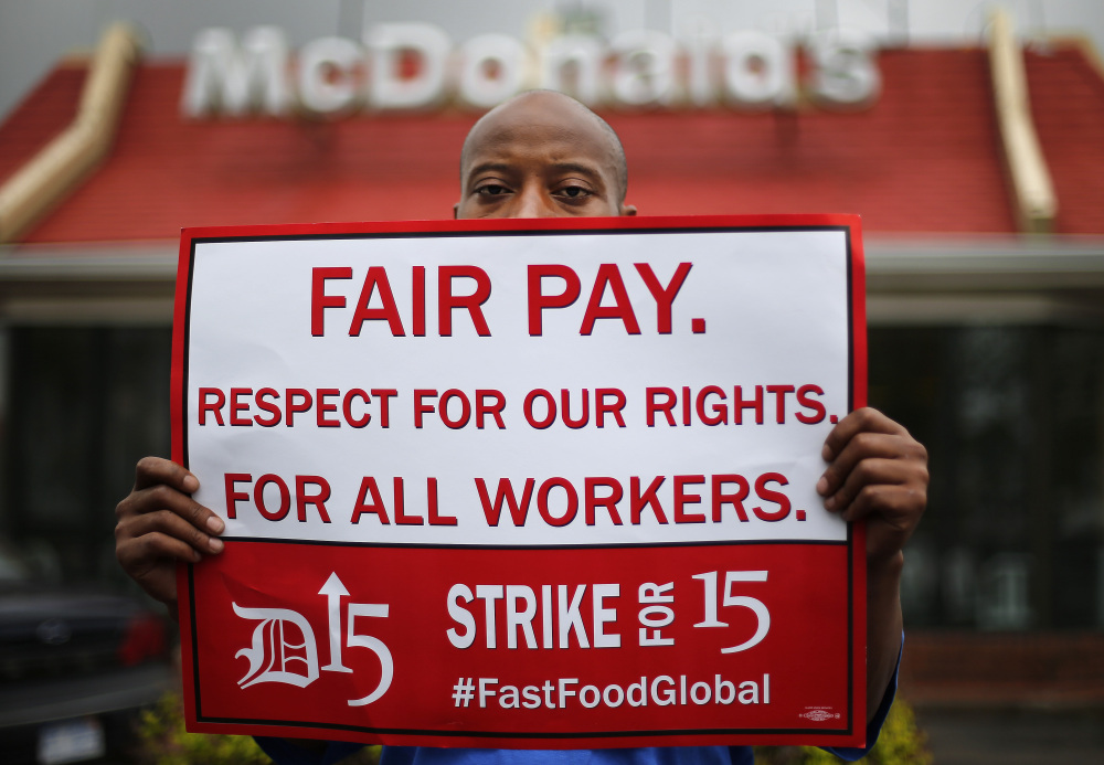 Emmanuel Dawson protests for higher pay Thursday outside a McDonald's restaurant in Detroit. Organizers said there were strikes and protests in 150 U.S. cities and 33 countries.
