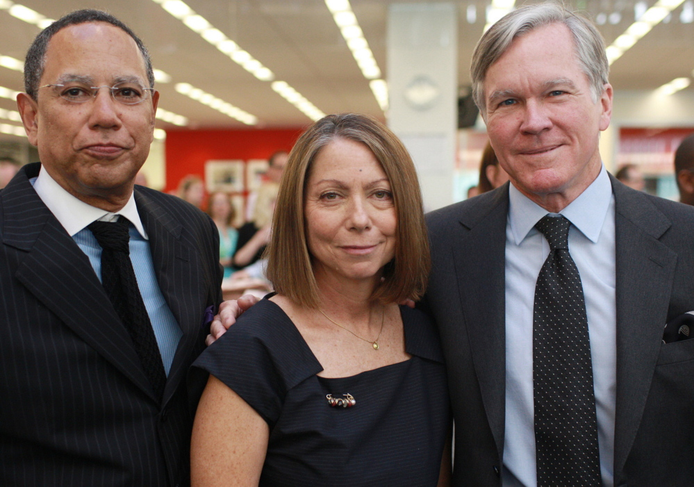 New York Times managing editor Dean Baquet, left, executive editor Jill Abramson and outgoing executive editor Bill Keller pose for a photo at the newspaper in 2011.