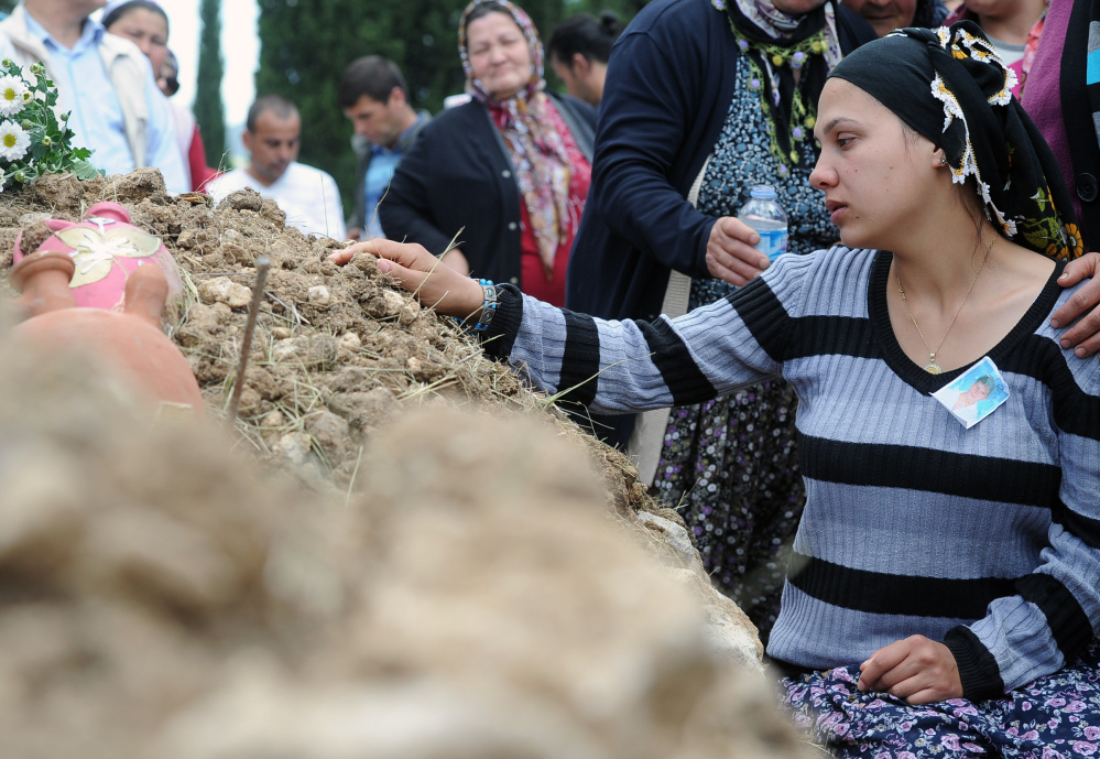 Family members attend a funeral for a victim of the mine accident in Soma, Turkey, on Thursday. Mourners say they spend their lives fearing a disaster at the mine.