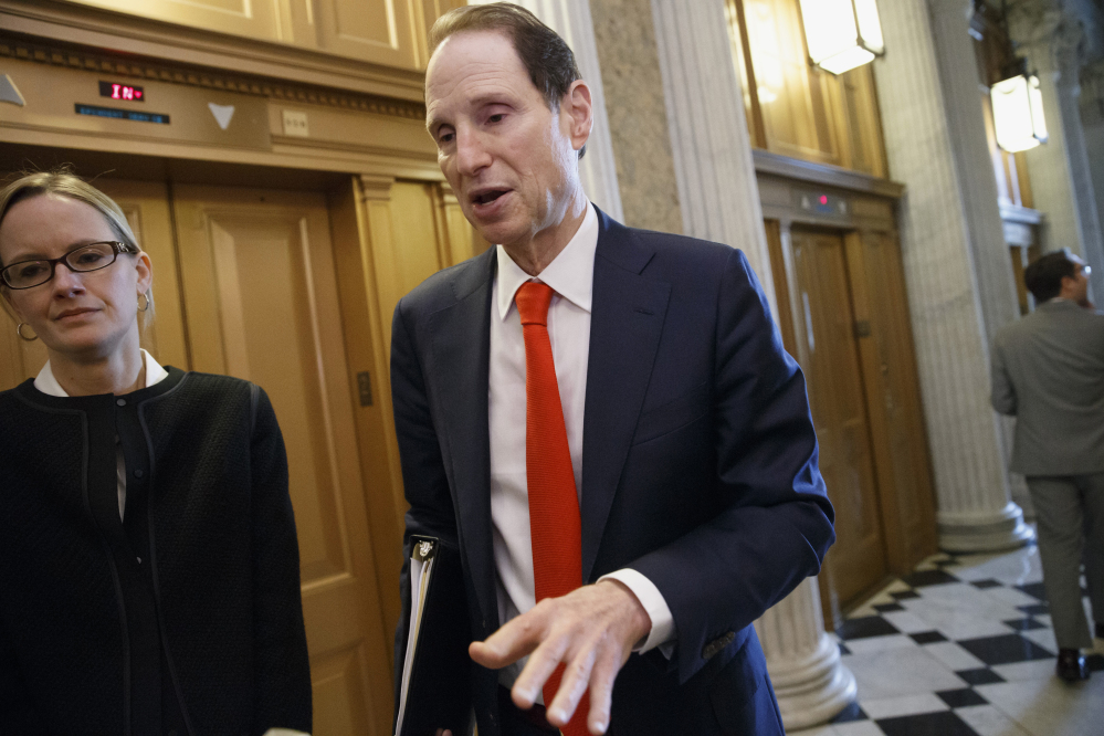 Senate Finance Committee Chairman Sen. Ron Wyden, D-Ore., speaks with reporters about legislation to extend tax breaks as he heads to the chamber for a vote Wednesday on Capitol Hill in Washington. Senate Republicans blocked a bill to renew more than 50 expired tax breaks for businesses and individuals.