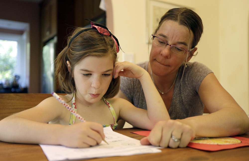 Stacey Jacobson-Francis works on math homework with her 6-year-old daughter, Luci, on Wednesday at their home in Berkeley, Calif. As schools implement national Common Core learning standards, parents say that grade-school math has become as complicated as calculus.