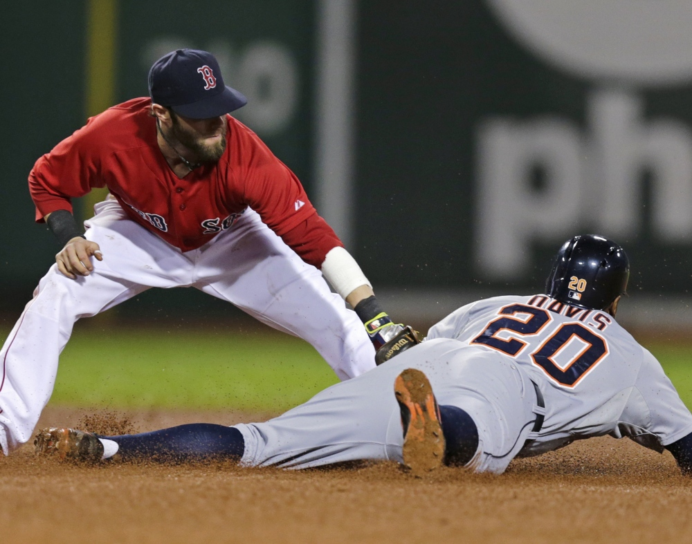 Detroit's Rajai Davis steals second base while the ball gets away from Boston infielder Dustin Pedroia during the fifth inning of the Tigers' 1-0 victory during a rain-delayed game at Fenway Park.