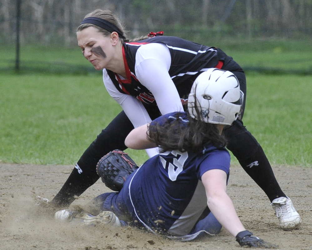 Maddie Taylor of Wells tags out Yarmouth's Cat Thompson during their Western Maine Conference softball game Friday in Wells. Taylor finished with three hits to help the Warriors improve to 9-1 with a 15-10 victory.