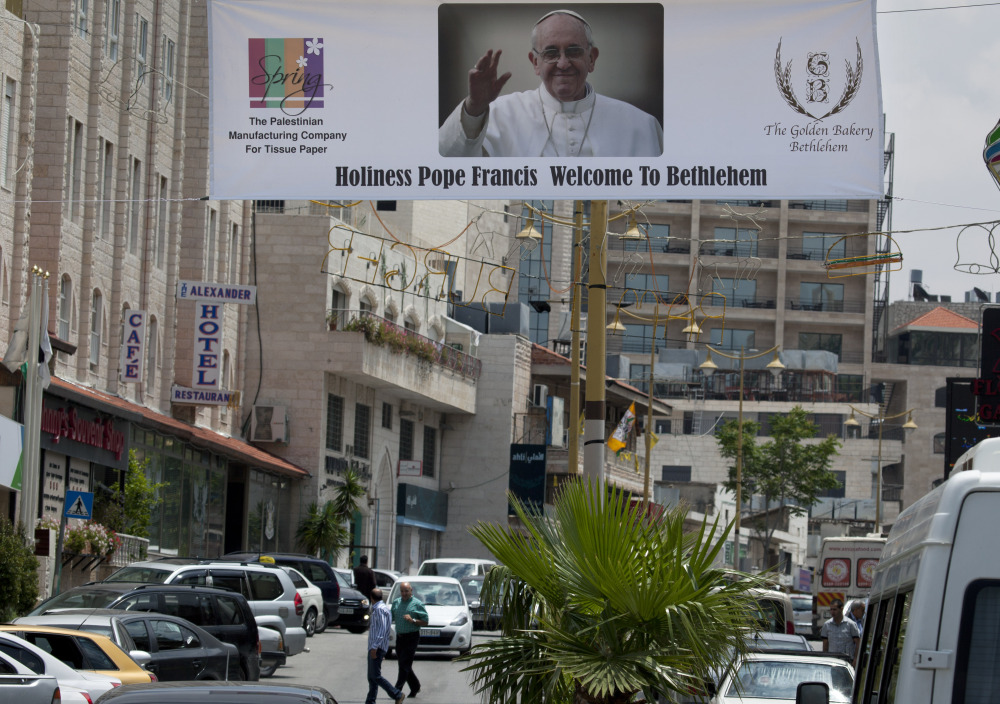 A welcome banner with a picture of Pope Francis hangs over a street near the Church of the Nativity in the West Bank city of Bethlehem. The church is one of the stops the pope will make during his upcoming visit to the Holy Land.