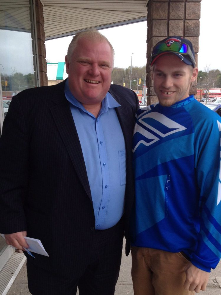 Toronto Mayor Rob Ford poses for a photo with Brody Lisle. Ford's lawyer had no comment on his client's progress.