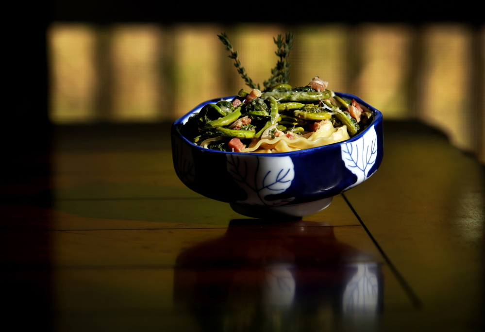 A dish of Mollie Sanders' Fiddlehead and Panchetta Pasta sits on her kitchen table in Kittery Point.