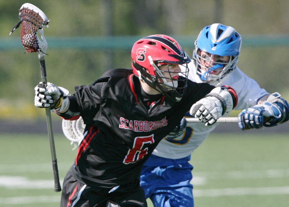 Scarborough's Nathan Howard, left, is defended by Tyler Jordan of Falmouth in a matchup of perennial lacrosse powers. The Red Storm couldn't recover from a 10-0 early deficit.