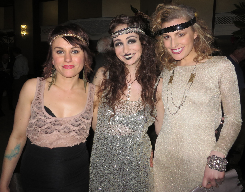 Alicja Bronk-Zdunowski, left, Erica Carey and Mary Quirk model 1920s-inspired jewelry by Portland artist Ponomo (Hannah Tarkinson).