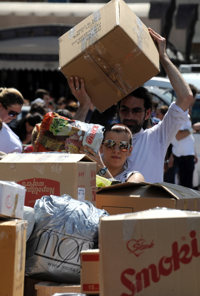 Citizens in Macedonia collect aid such as food, hygienic products, clothing and bottled water intended for the flooded regions in Serbia and Bosnia.