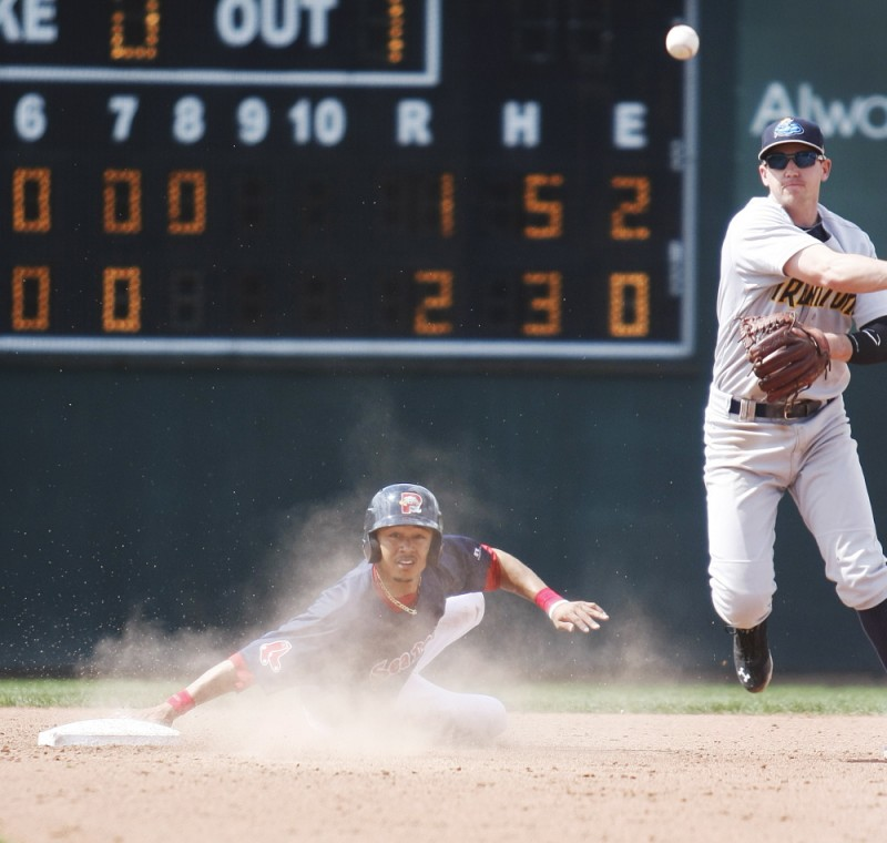 """Portland's Mookie Betts is the first out of an eighth-inning double play turned by Trenton Thunder shortstop Carmen Angelini in a 2-1 loss to the Sea Dogs on Sunday. Betts went 1 for 3 and played center field for the first time as a professional. According to a Red Sox official, the hot-hitting prospect is being """"exposed"""" to the outfield."""