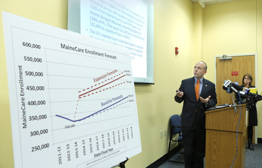 Gary Alexander of the Alexander Group gives his analysis of a report his group developed regarding the cost of expanding MaineCare at the Department of Health and Human Services in Augusta in January.