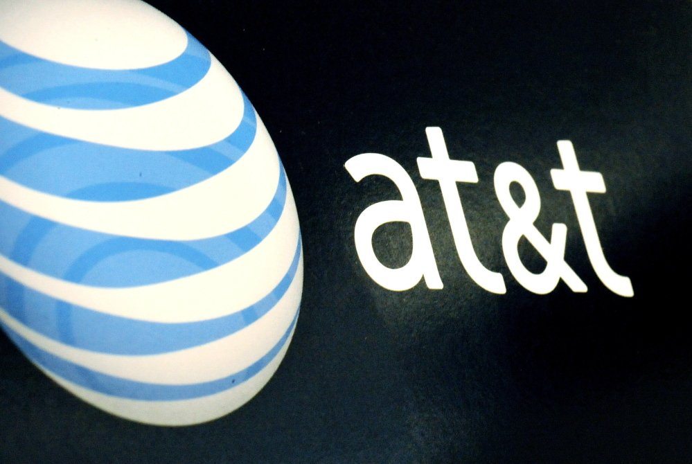 In this Oct. 19, 2009 file photo, the AT&T logo is on display at a RadioShack store in Gloucester, Mass. AT&T says it is buying DirecTV for $95 per share, or $49 billion, a move that gives the telecommunications company a larger base of video subscribers and increases its ability to compete against Comcast and Time Warner Cable, which agreed to a merger in February.