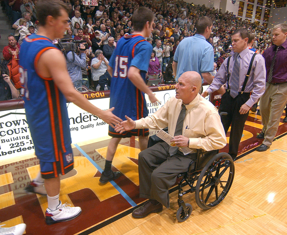 Don Meyer, then Northern State University men's basketball coach, shakes hands with a University of Mary player after he got his 903rd win, passing Bobby Knight as the NCAA's winningest coach in men's basketball history, in Aberdeen, S.D., in 2009