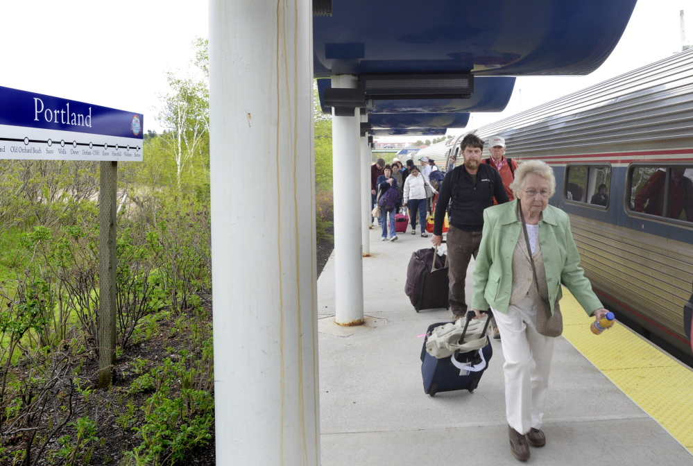 """Passengers arrive late aboard the Downeaster in Portland on Monday. """"It doesn't bother us one bit,"""" said Andrew Olson of Greenfield, who was picking up his son at the station. """"It's a wonderful ride and a great service."""""""