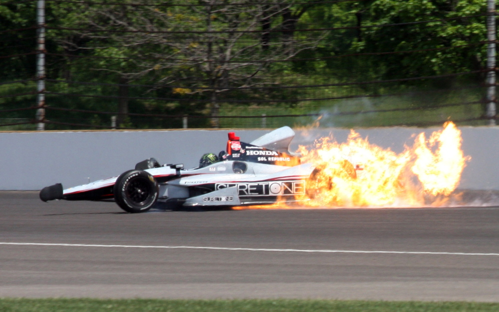 The car driven by Kurt Busch catches fire after hitting the wall in the second turn during practice for the Indianapolis 500 IndyCar auto race at the Indianapolis Motor Speedway on Monday.