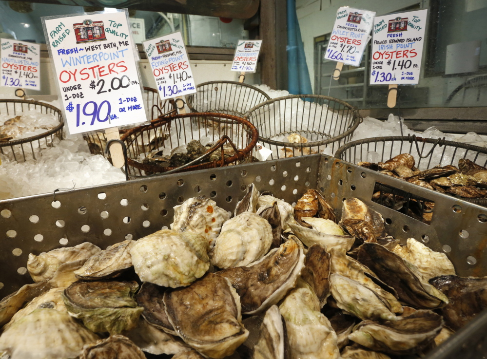 Locally harvested oysters for sale at Harbor Fish Market have signs that are clear about their source – fresh and farm-raised in West Bath or from other local waters.