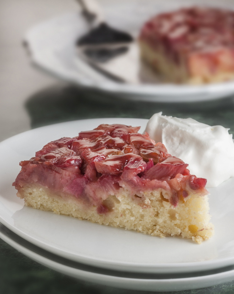 This upside-down cake is a good way to dispose of some of the rhubarb that's shooting up now in home gardens.