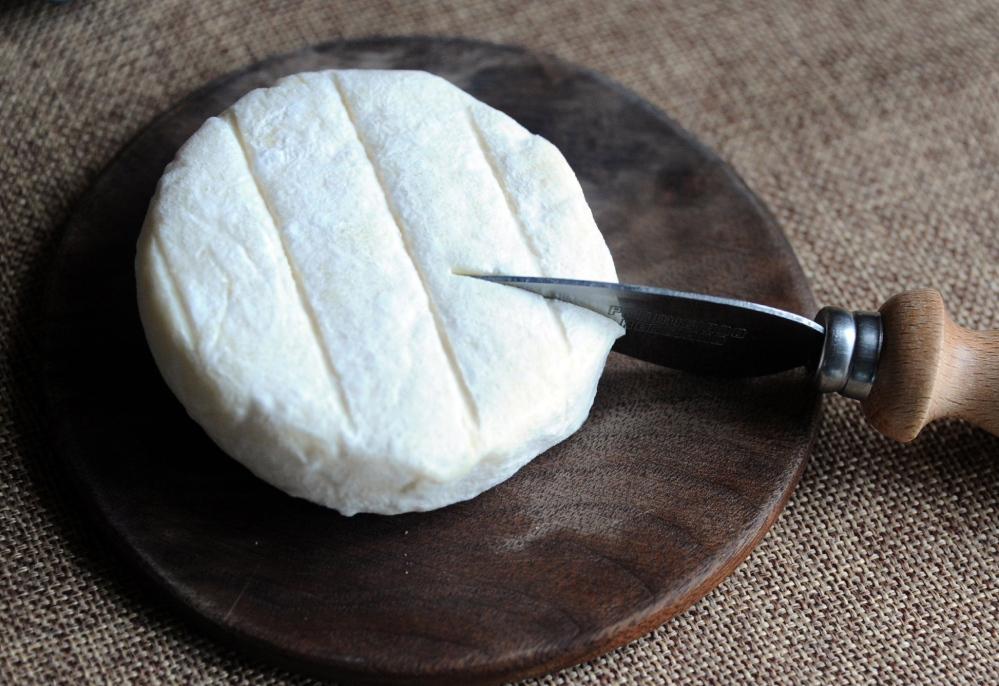Dragonfly, a white-rind cheese made from cow's and goat's milk, is one of the cheeses produced at The Farm at Doe Run.