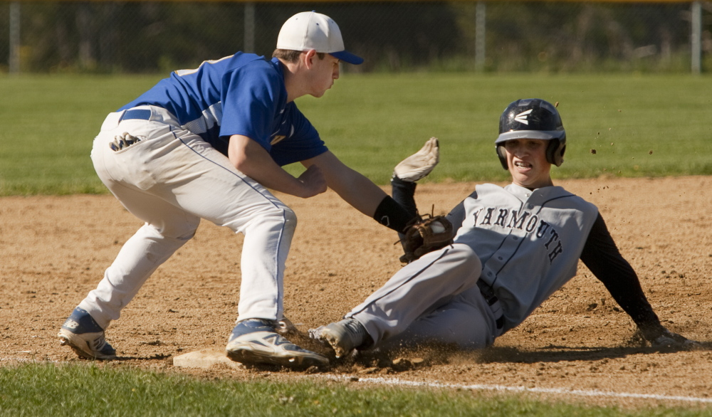 Falmouth third baseman Noah Nelson places the tag on C.J. Cawley of Yarmouth during Falmouth's 12-2 victory Wednesday in a Western Maine Conference game. The Yachtsmen improved to 9-2 and dropped Yarmouth to 6-5.