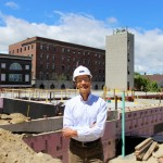 John Ryan visits a Wright-Ryan Construction housing project at 409 Cumberland Ave. in Portland. The firm is known for its environmentally friendly business practices.