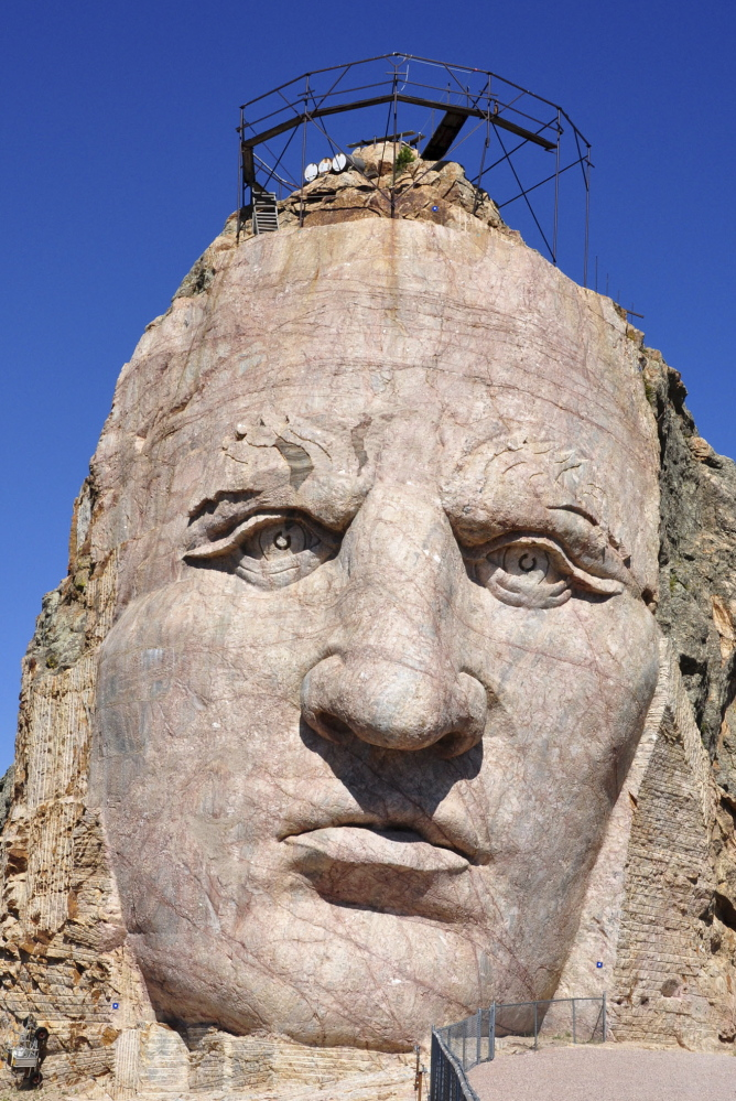 The 87-foot-6-inch tall face of the Crazy Horse mountain carving near Custer, S.D.