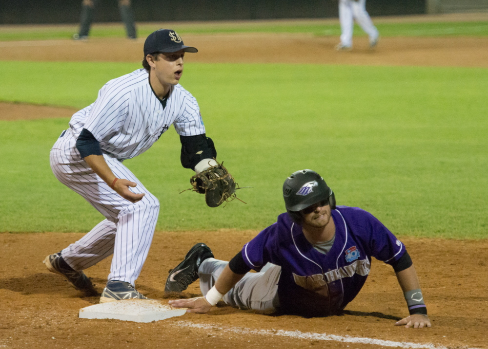 University of Southern Maine first baseman John Carey looks for a call Friday night after Mikole Pierce of Wisconsin-Whitewater made it back to the bag on an attempted pickoff. USM lost 8-1 and will face Salisbury, Md., in an elimination game at 2:15 p.m. Saturday.
