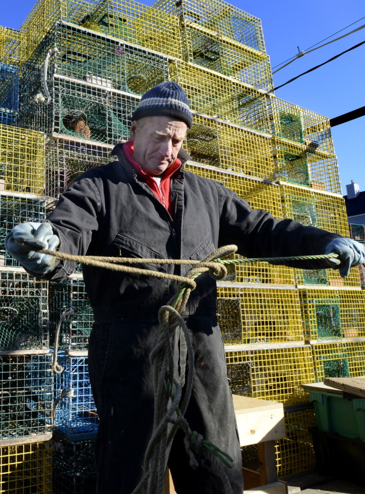 Portland fisherman David MacVane, 80, tends to lobster traps. Ocean acidification threatens all shellfish.