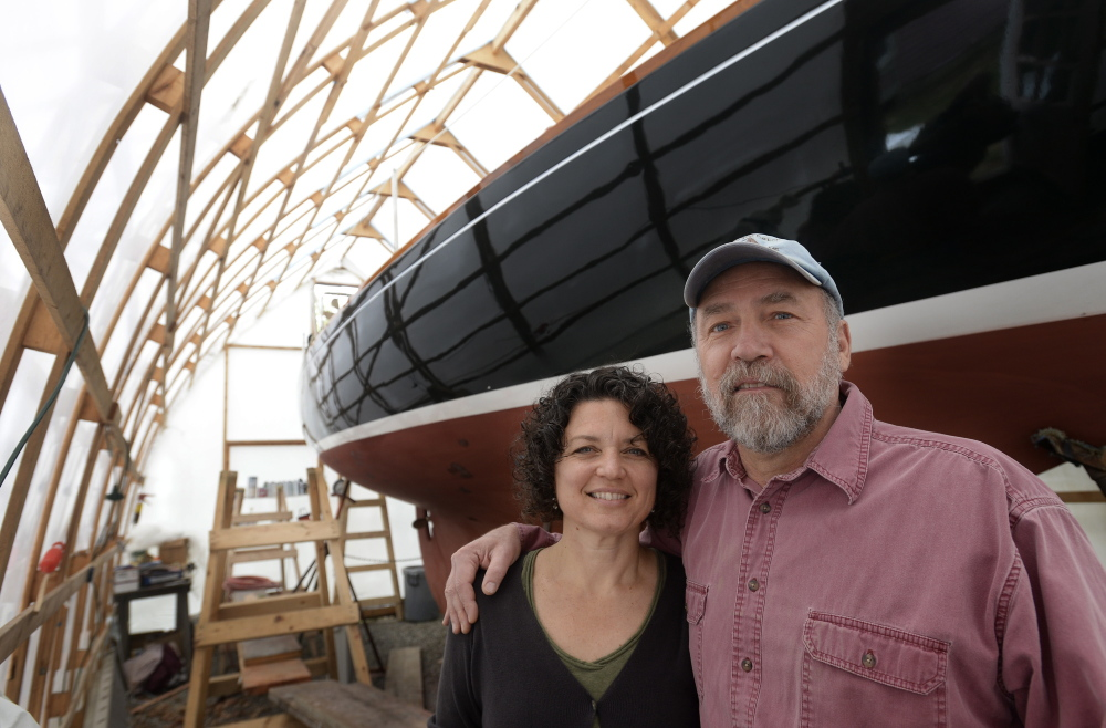 North Berwick artists Kim Bernard and Christos Calivas with Calivas's 30-foot sailboat, which he will skipper up and down the Maine coast this summer