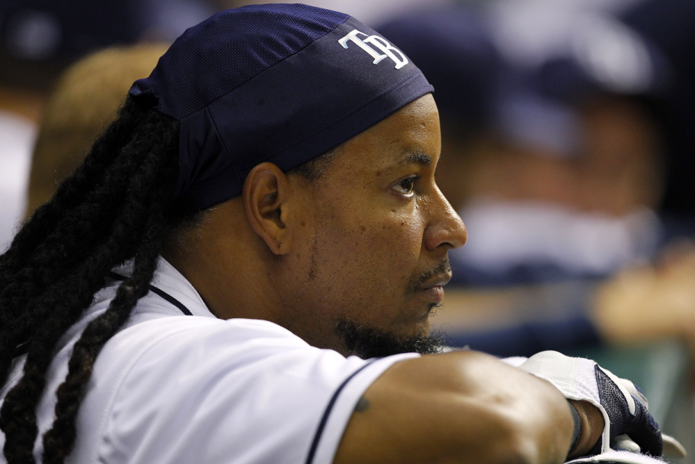 Manny Ramirez, who won two World Series with the Red Sox, was signed by the Cubs Sunday to be a player-coach for Triple-A Des Moines.