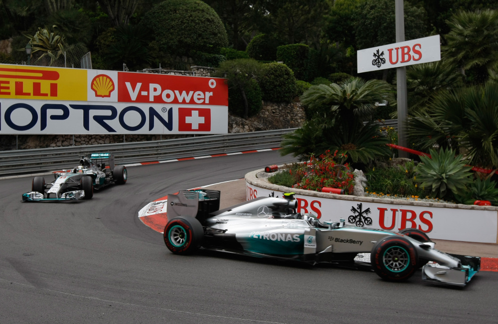 Mercedes driver Nico Rosberg of Germany leads Mercedes driver Lewis Hamilton of Britain , during the Monaco Formula One Grand Prix, at the Monaco racetrack, in Monaco, Sunday.