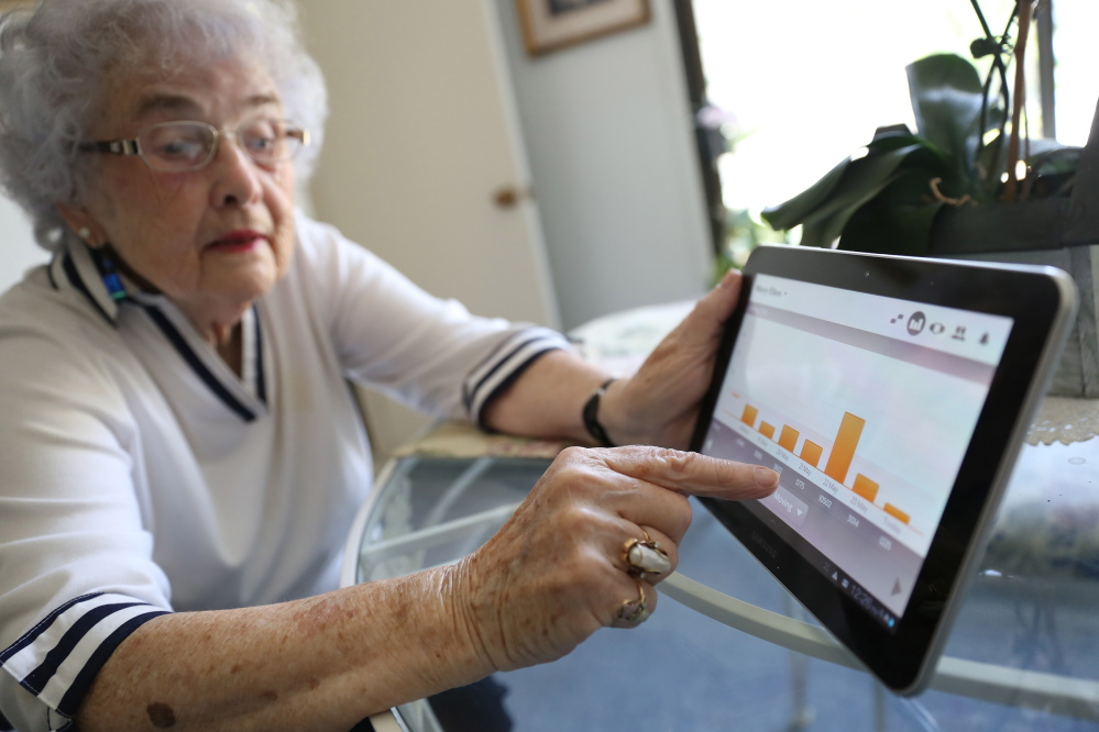 Mary Ellen Snodgrass of Redwood City, Calif., describes how the smart pills that she takes daily send information that she can see on her tablet, such as the number of steps she takes in a day or how much time she spends sitting.