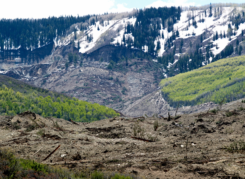 Grand Mesa, where the slide started, is in a remote part of western Colorado near the small town of Collbran. Rescue teams are searching for three men after a half-mile stretch of a ridge saturated with rain collapsed.