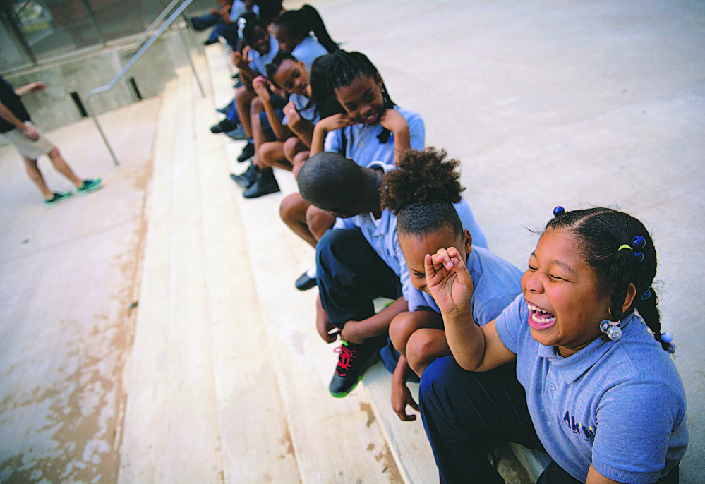 Ashiria Glasper, 6, and classmates take part in a physical education class at Akili Academy charter school, created by a $24 million restoration of an old New Orleans public school. Photo for The Washington Post by Edmund D. Fountain