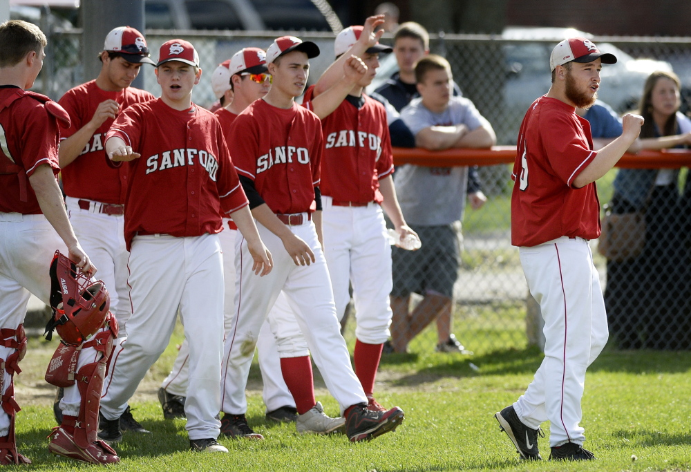 BIDDEFORD ME - MAY 20: Sanford's CJ Bulduc, right, is the first off the bench to cheer on teammates after getting out of an inning against Biddeford Tuesday, May 20, 2014. (Photo by Shawn Patrick Ouellette/Staff Photographer)