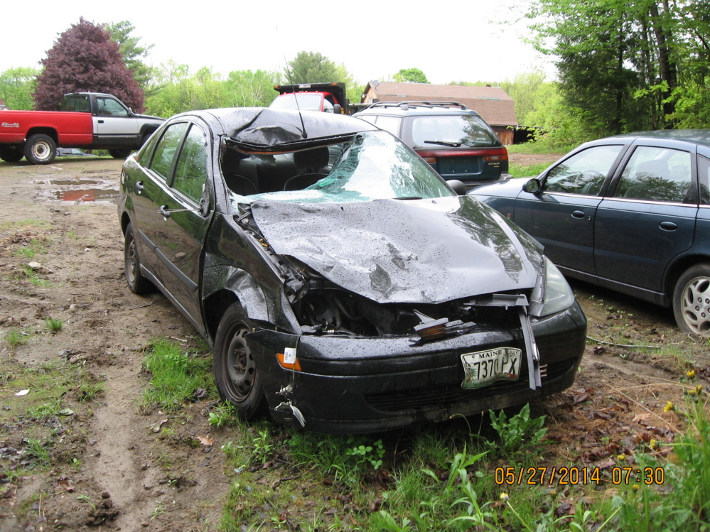 Three people escaped injury Saturday when a 2003 Ford Sedan struck a cow on Main Street in Readfield.