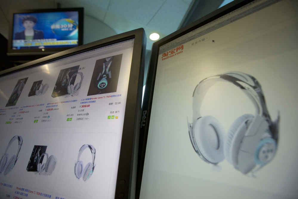 Computer screens display the website of Alibaba's Taobao site selling the Monster Tron T1 headphones, in Beijing on Tuesday. But buyer beware because Monster Inc. never produced this model.