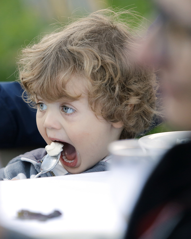 Marek Osucha-Middleton, 2, of Lewiston digs into some dessert during a