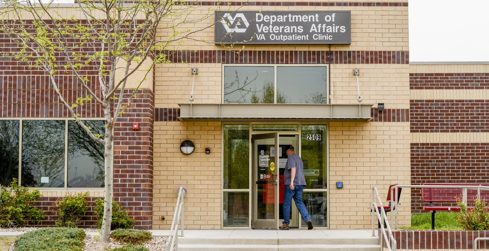 A man enters the Department of Veterans Affairs Outpatient Clinic in Fort Collins, Colo. One of the tricks used by employees to meet appointment time limits included making appointments, but not telling the patient.