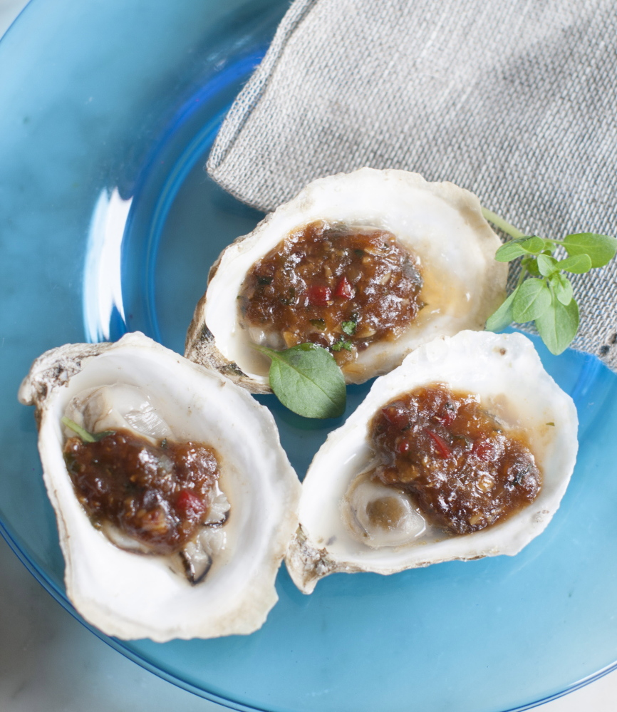 Grilled oysters with fermented black beans and chili garlic are inspired by chefs at the South Beach Wine and Food Festival in Miami Beach.