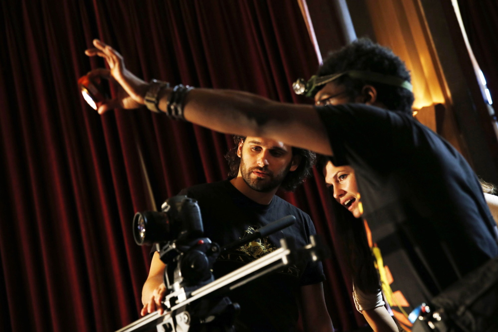 """Director KT Kent, center, with cinematographer Anthony Pietromonaco, left, and grip Cornell Mitchell on the set of  """"Lockhart,"""" which has a budget of $500,000. Robert Gauthier/McClatchy Newspapers"""