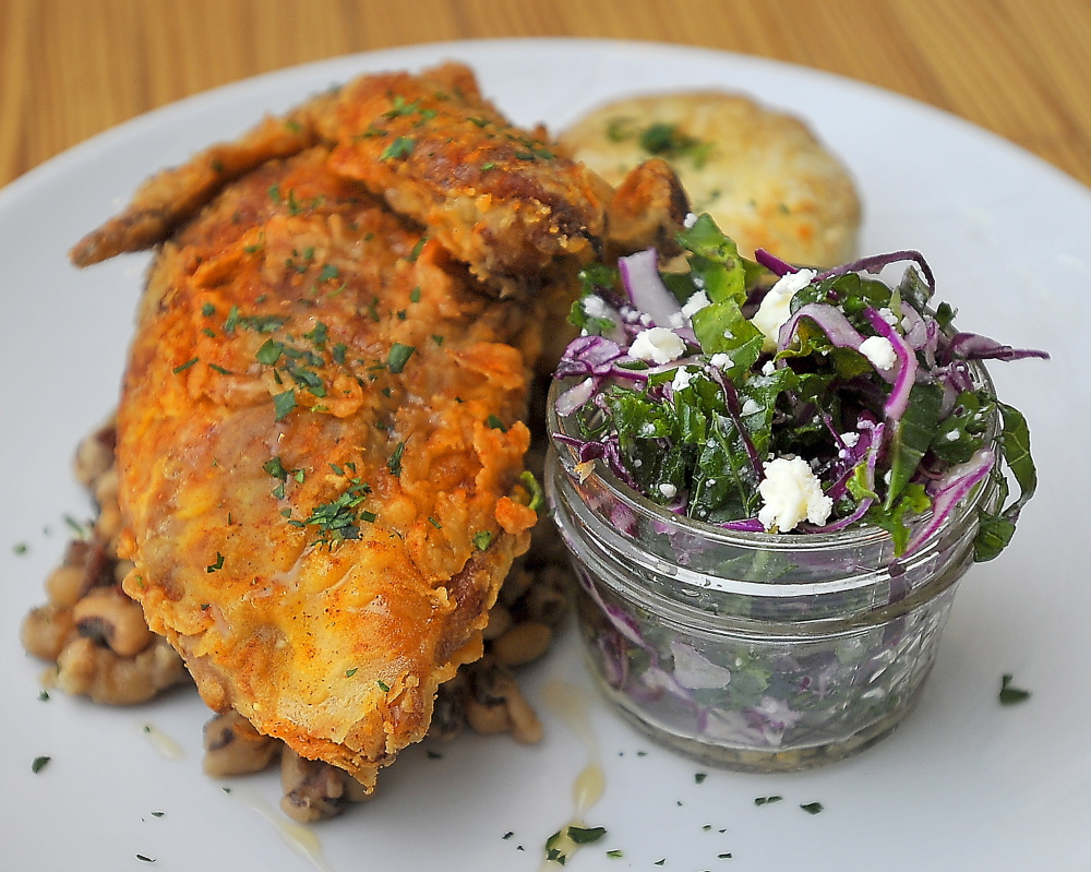 Cold-smoked free-range chicken breast with Tabasco honey is served at 3 Crow with kale slaw, black-eyed peas and a fresh buttermilk biscuit.