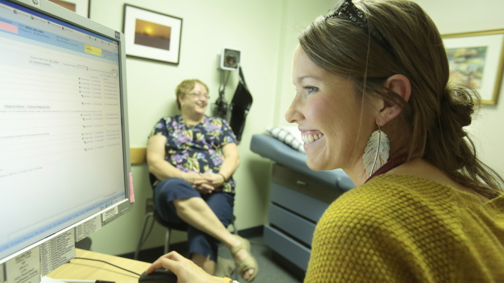 Rebecca Wood, right, visits the primary care practice of Dr. William Medd in Norway last month, while the doctor was seeing his patient Darlene Glover. Wood, who mentored with Medd, says she hopes to return to practice medicine in Maine after she completes her residency in New Hampshire.