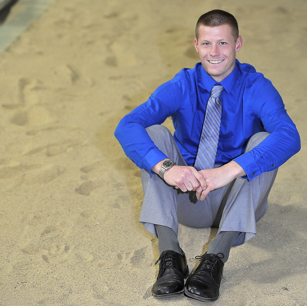 GORHAM, ME - MAY 29: Portrait of Jamie Ruginski, triple jump champion, in the sand pit he calls home, at Costello Fieldhouse on USM campus in Gorham. (Photo by Gordon Chibroski/Staff Photographer)