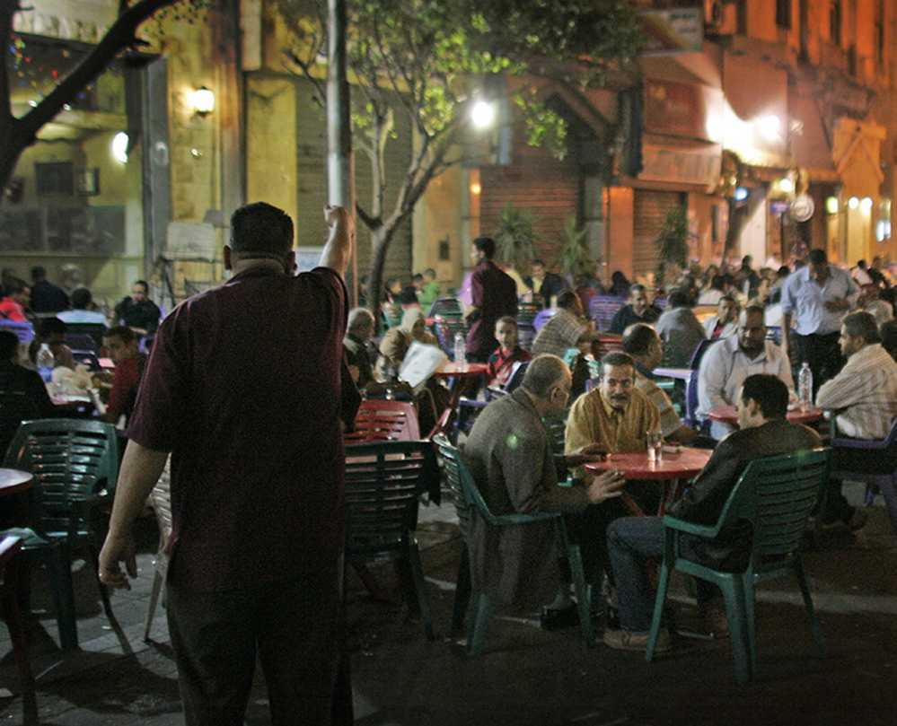 Customers of all shapes and sizes sit at street cafes in central Cairo, Egypt The Associated Press