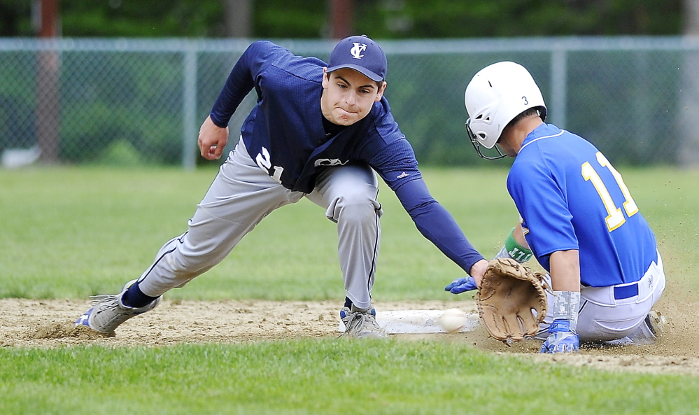 Luke Velas of Falmouth steals second base Friday as Cody Cook of Yarmouth attempts to catch the throw during Falmouth's 5-4 comeback victory. Gordon Chibroski/Staff photographer