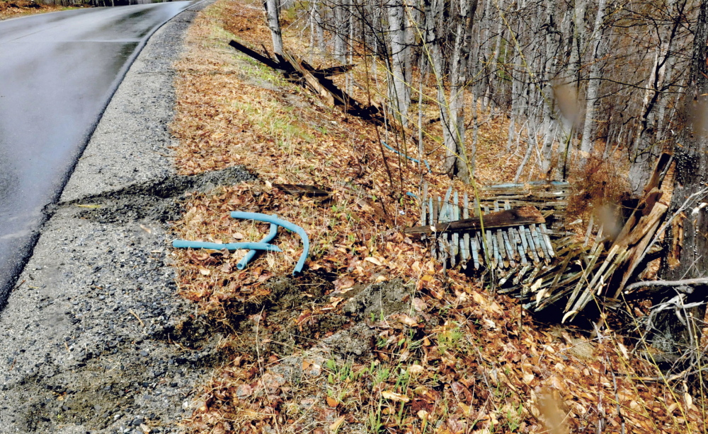 David Leaming/Morning Sentinel Tire tracks remain in the shoulder of Penney Road in Belgrade after someone apparently backed up and dumped piles of debris there recently.