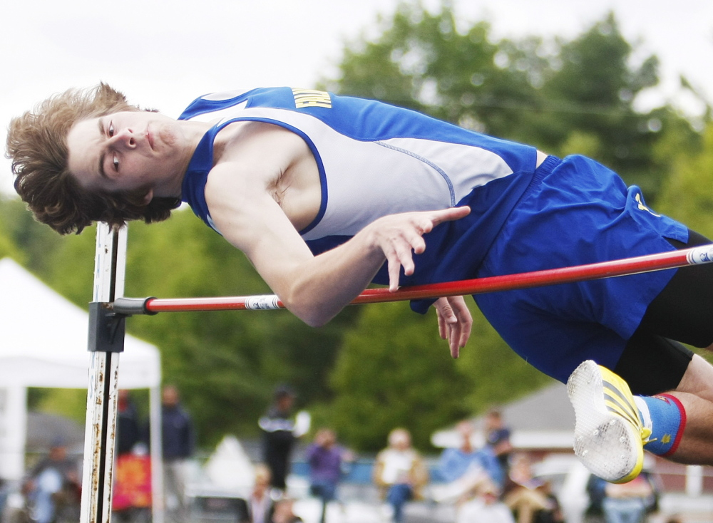 Tony St. Angelo of Falmouth clears 6 feet in the high jump in the Western Maine Conference track and field championships at Lake Region High. St. Angelo finished second behind Kennebunk's Austin Wiegle (6-2).